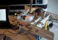A Raspberry Pi controlled Eggbot printing on a golf ball