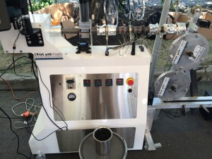 The Extruder making filament at Maker Faire