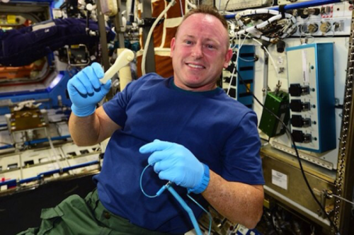 Commander Barry Wilmore shows off a 3D printed ratchet. Photo: NASA