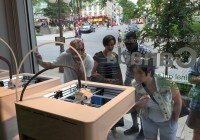 Customers watch the 3D printers in Quebec City